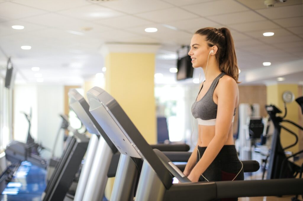 girl running treadmill gym training