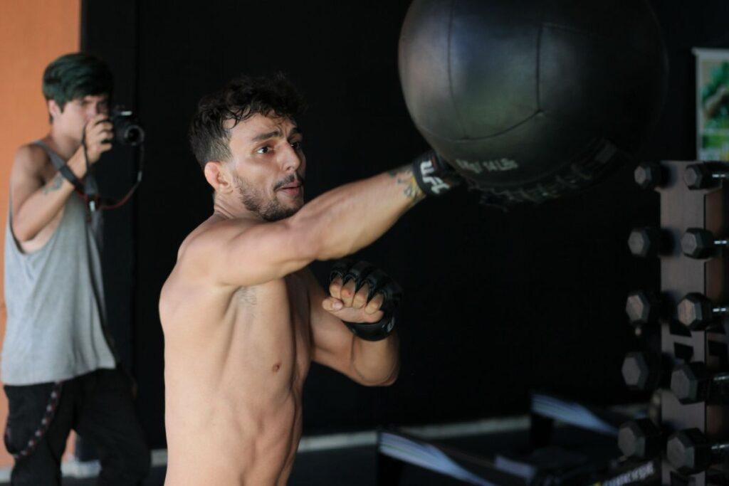 Guy Training Punching Bag
