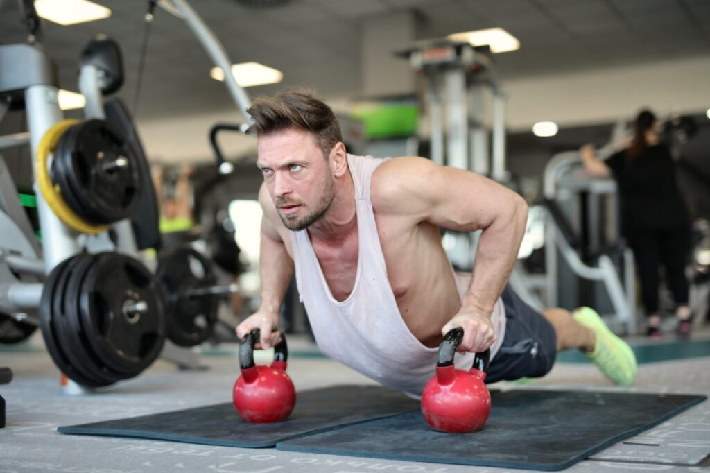 man dumbbell gym training