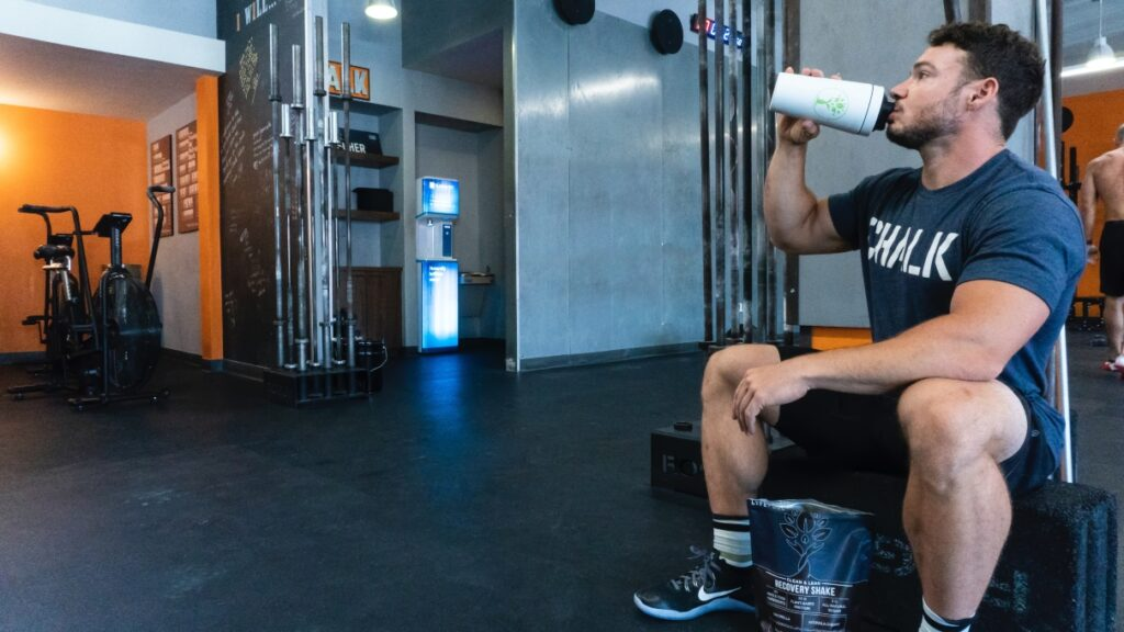 man protein shake gym training