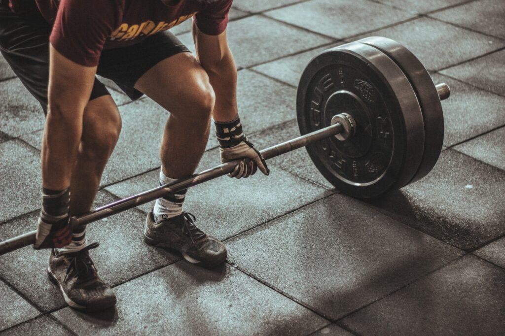 man squat gym