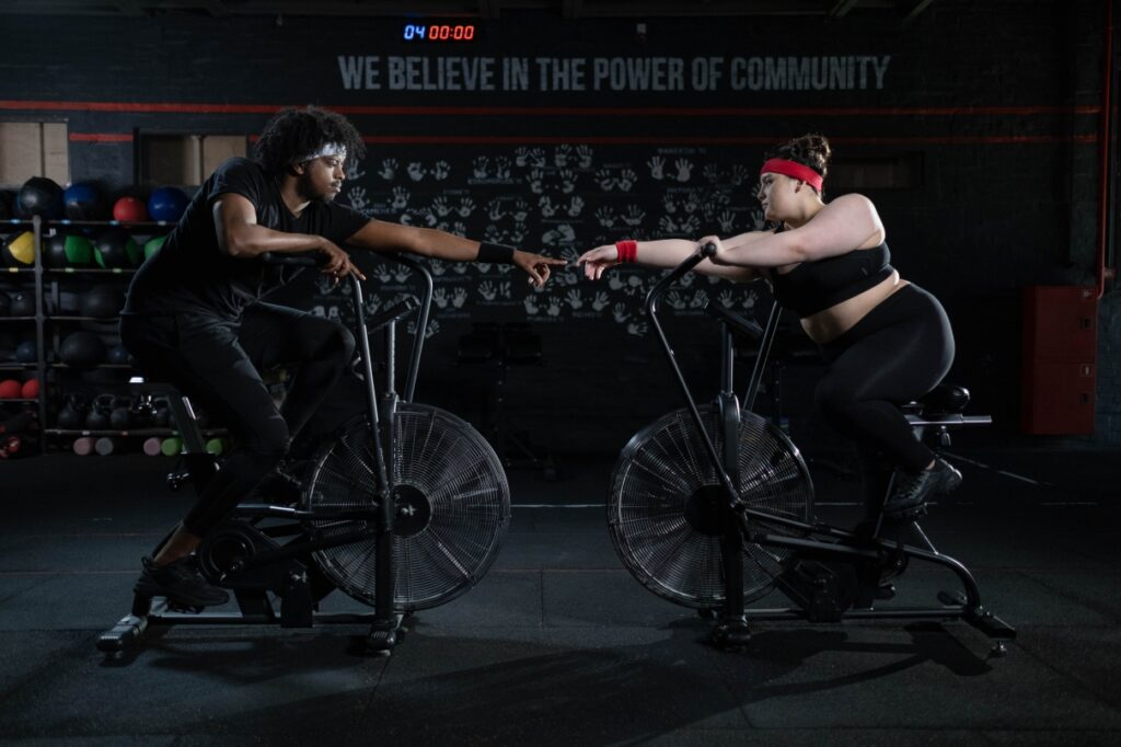 man woman gym bike