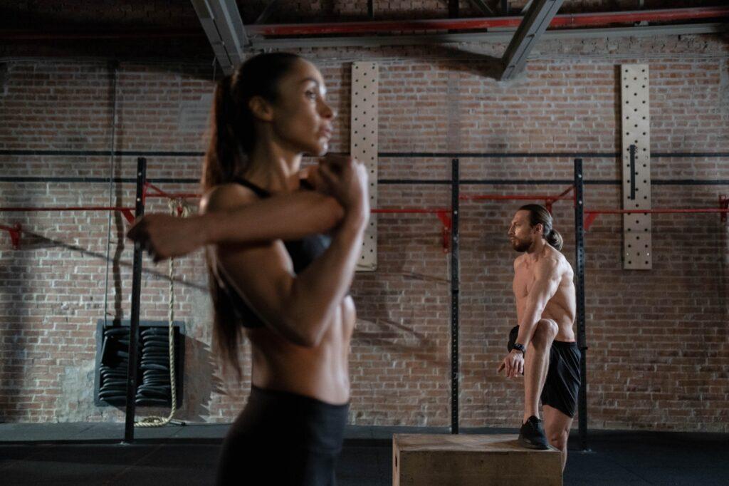 woman man stretching gym