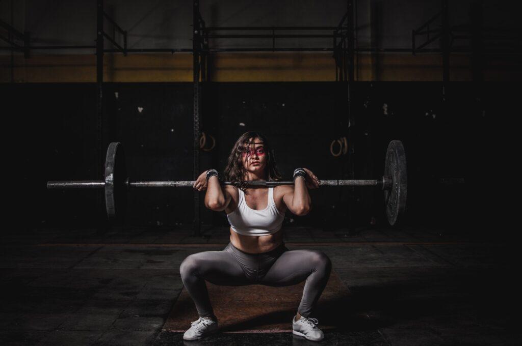 woman squat gym training